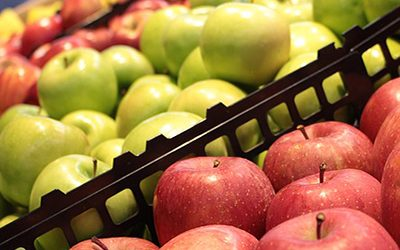red and green apples in supermarket