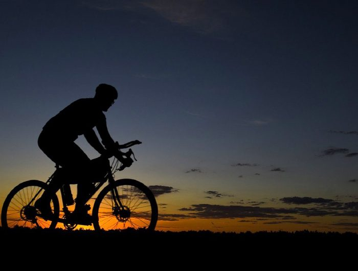 Cycling At Sunset On Hilltop