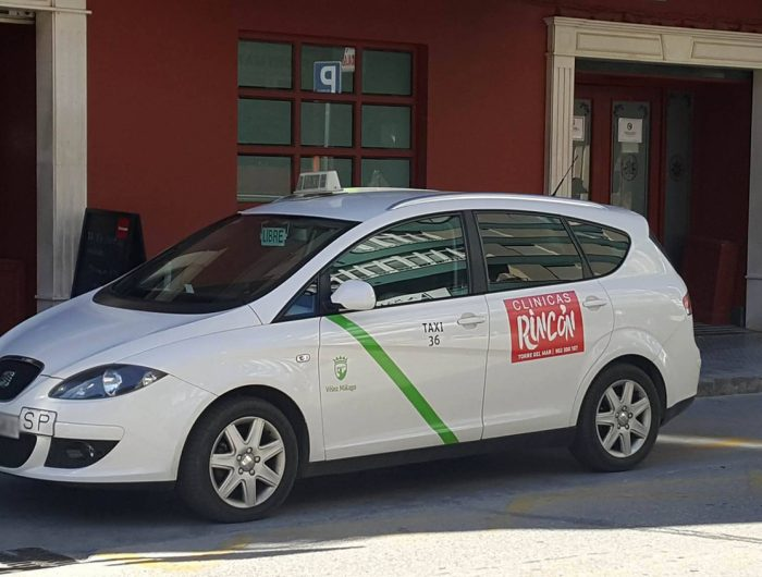 taxi rank in spain with white taxi