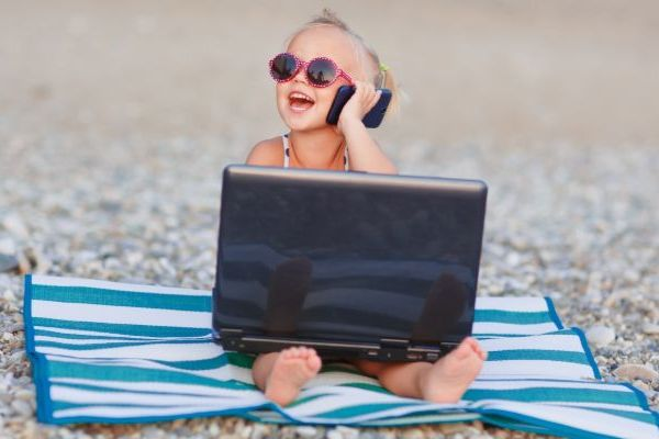 Toddler on Beach with Laptop